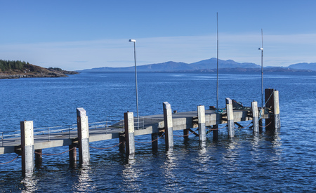 Small empty mooring pier with bumpers, Edoya island, Trondheim region, Norway