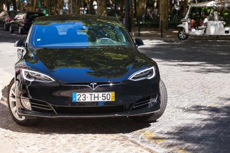 Lisbon, Portugal - August 16, 2017:  Black Tesla model S, full-size all-electric five-door car, luxury liftback, produced by Tesla Motors Editorial