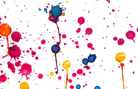 Colorful paint splashes on white paper, closeup background photo texture
