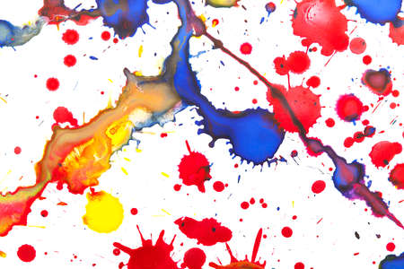 Colorful paint splashes over white paper, closeup background photo texture Stock Photo