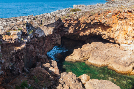 Boca do Inferno. Hells Mouth chasm located in seaside cliffs. Natural landmark of Cascais city in the District of Lisbon, Portugal Stock Photo
