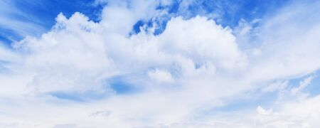 White cumulus clouds in blue sky at summer day, natural panoramic photo background texture Stock Photo