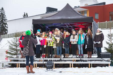 Hamina, Finland - December 13, 2014: choir of Finnish girls sing on Christmas fair in Hamina