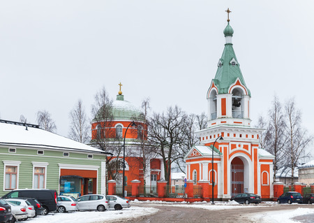 Hamina, Finland - December 13, 2014: Church of St. Peter and St. Paul. It was built in 1837, designed by Italian-French architect Louis Visconti. Ordinary people walk nearby Editorial
