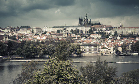 Panoramic view of Old Prague with St. Vitus Cathedral and Charles Bridge. Stylized photo with vintage tonal correction effect Stock Photo