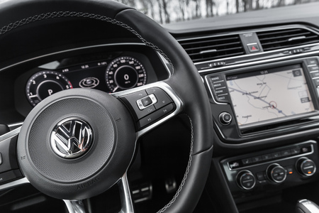 Hamburg, Germany - February 10, 2017:  Interior of second generation Volkswagen Tiguan, 4x4 R-Line. Compact crossover vehicle manufactured by German automaker Volkswagen, steering wheel with logotype Editöryel