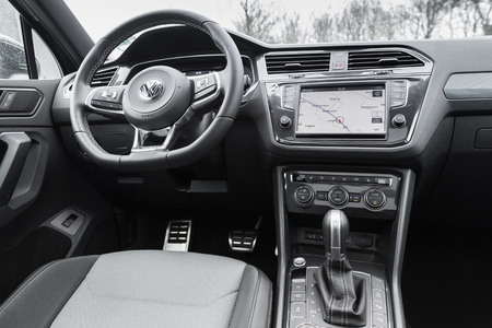 Hamburg, Germany - February 10, 2017:  Interior of second generation Volkswagen Tiguan, 4x4 R-Line. Compact crossover vehicle manufactured by German automaker Volkswagen, steering wheel and dashboard