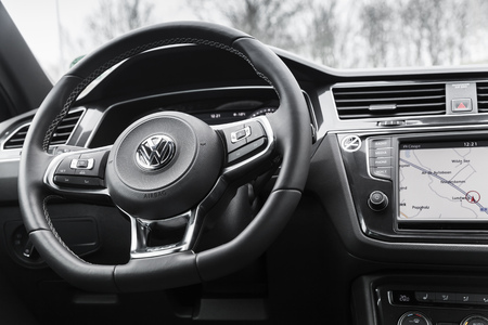 Hamburg, Germany - February 10, 2017:  Interior of second generation Volkswagen Tiguan, 4x4 R-Line. Compact crossover vehicle manufactured by German automaker Volkswagen, steering wheel Editöryel