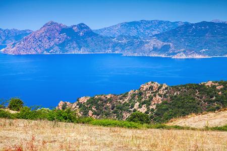 Summer panoramic coastal landscape of Corsica. Piana region, France