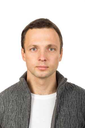 Closeup studio face portrait of young European man isolated on white background