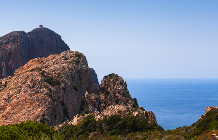 Landscape of French Mediterranean island Corsica. Corse-du-Sud, Piana region, tower on the rock Stock Photo