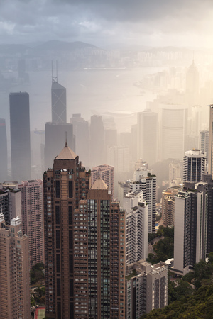 Modern skyline of Hong Kong city, aerial view taken from Victoria Peak viewpoint in foggy day