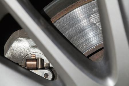 Car wheel fragment with brake disc, closeup photo with selective focus