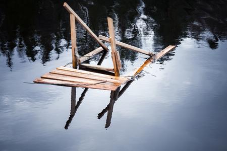 Broken wooden gangway to the river