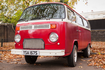 London, United Kingdom - October 29, 2017: Volkswagen Type 2 red van stands parked in the autumn city, close up photo Editorial