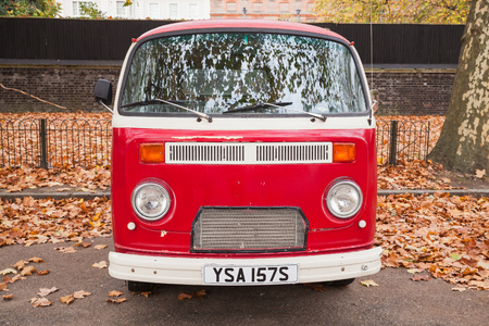 London, United Kingdom - October 29, 2017: Volkswagen Type 2 or T2 red van stands parked in the autumn city, front view Editorial