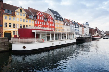 Old ships moored in Nyhavn, 17th-century waterfront, canal and popular touristic district in Copenhagen, Denmark Stock Photo