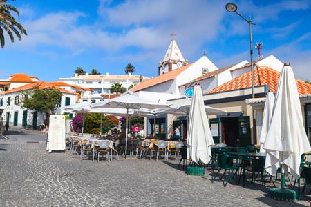 Vila Baleira, Portugal - August 18, 2017: Street view of Largo do Pelourinho street. Vila Baleira the only city and the capital of Porto Santo Island, Madeira, ordinary people sit in the restaurant Editorial
