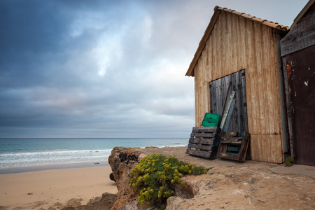 Wooden barns on the beach in early morning. Porto Santo island in the Madeira archipelago, Portugal Stock Photo