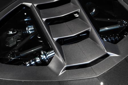 Luxury Italian sports car fragment, rear aerodynamics carbon spoiler covers engine compartment