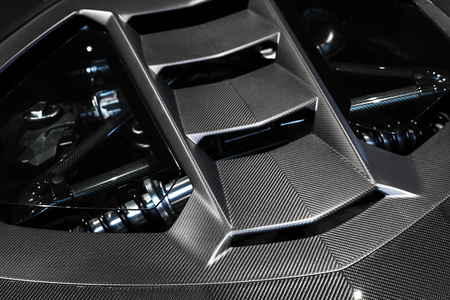 Luxury Italian sports car fragment, rear aerodynamics carbon spoiler covers engine compartment
