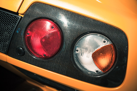 Rear lights on a luxury yellow sports car, close up-photo
