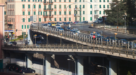 Genova, Italy - January 18, 2018: Urban transportation scene, cars go on overpass with road junction Editorial
