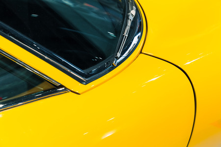 Body parts of luxury vintage yellow roadster, Italian car design