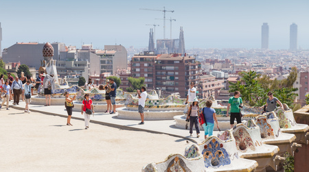 Barcelona, Spain - August 26, 2014: Tourists and visitors of Guell park in summer day