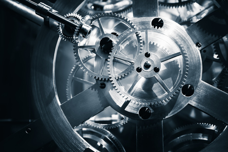 Vintage clock mechanism, close-up fragment with shiny gears, blue toned photo Archivio Fotografico