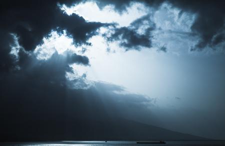 Dark stormy clouds and sunlight, landscape background photo. Izmir, Turkey. Blue toned photo Reklamní fotografie