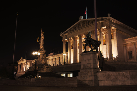 Austrian Parliament at night, was erected between 1893 and 1902 by Carl Kundmann, Josef Tautenhayn, Hugo Haerdtl 写真素材