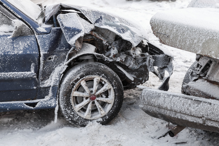 Crashed cars in accident on winter road with snow