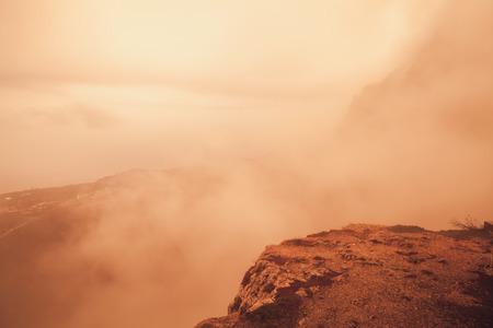 Red toned mountain landscape of Foros in foggy spring morning. Crimea peninsula, Black Sea coast