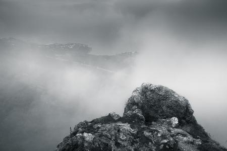 Monochrome mountain landscape of Foros in foggy spring morning. Crimea peninsula, Black Sea coast