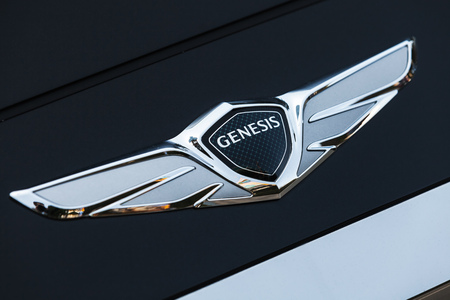 Busan, Republic of Korea - March 17, 2018: Logotype of Hyundai Genesis, luxury sedan manufactured and marketed by Hyundai. Close up photo, with selective focus