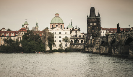 Charles Bridge over Vltava river in Old Prague. Czech Republic. Vintage toned photo