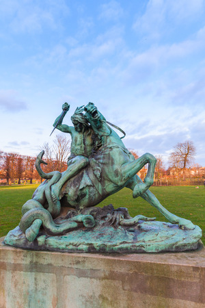 Sculpture Fight with Snake in Rosenborg Castle Gardens or Kongens Have literally The Kings Garden is the oldest and most visited park in central Copenhag