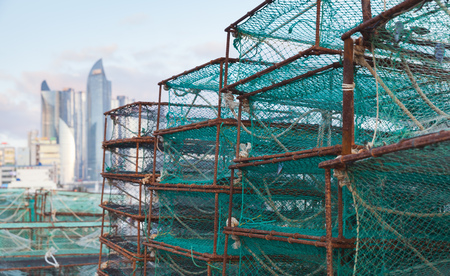 Traps for crabs lay in fishing port of Busan, South Korea. Boxes with green net