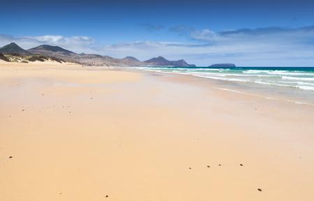 Wide empty sandy beach landscape Porto Santo island in summer, Madeira archipelago, Portugal