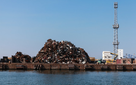 Big pile of rusted scrap metal lies on the quay in Burgas port, Bulgaria Stock Photo