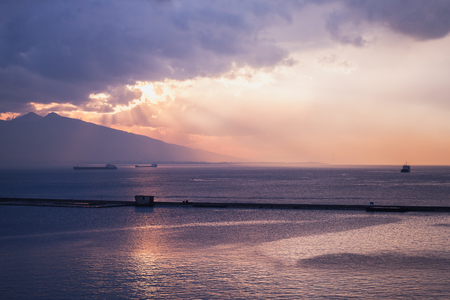 Colorful dramatic sunset over Mediterranean sea. Izmir bay landscape, Turkey