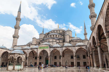 Istanbul, Turkey - June 28, 2016: Sultan Ahmed Mosque, one of the most popular city landmarks. It was built between 1609 and 1616 during the rule of Ahmed I. Ordinary people walk in inner courtyard