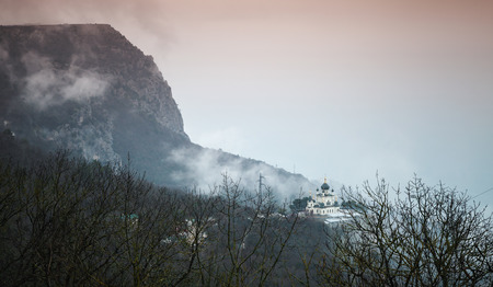 Dark mountain landscape with the Church of Christs Resurrection. It is a popular tourist attraction on the outskirts of Yalta in the Crimea Stock Photo