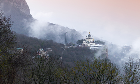 Mountain landscape with the Church of Christs Resurrection. It is a popular tourist attraction on the outskirts of Yalta in the Crimea Stock Photo