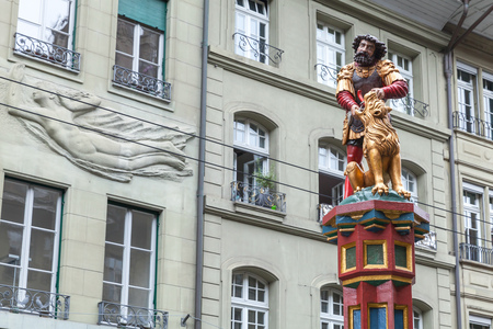 Simsonbrunnen or Samson fountain represents the Biblical story of Samson killing a lion. Bern, Switzerland. The fountain, built in 1544 by Hans Gieng