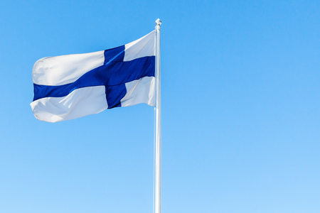 Flag of Finland or Blue Cross Flag over blue sky background 写真素材