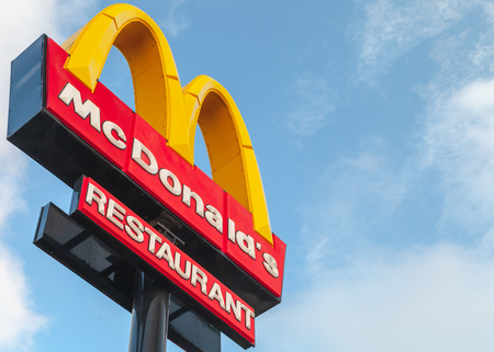 Ayia Napa, Cyprus - June 13, 2018: Mc Donalds restaurant logotype sign under blue cloudy sky Éditoriale