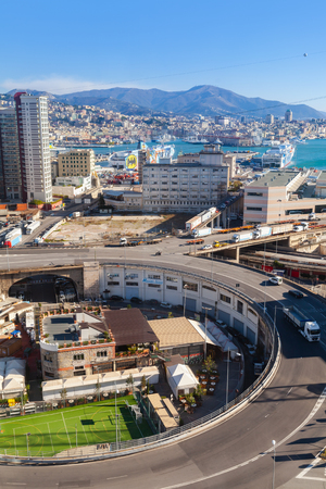 Genova, Italy - January 17, 2018: Genova city round overpass and modern buildings, industrial port district. Vertical photo