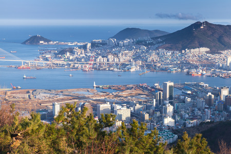 Busan city, South Korea. Aerial view with coastal buildings and ships